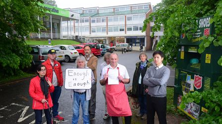 Earlham House traders held a demonstration about the parking management of their car park, which the