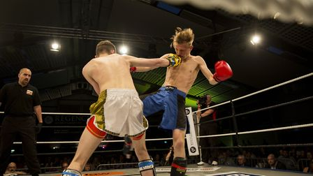 Ben Sell, left, and Jack Purdy clashed in a remarkable fight which saw Sell retain his title on a ma