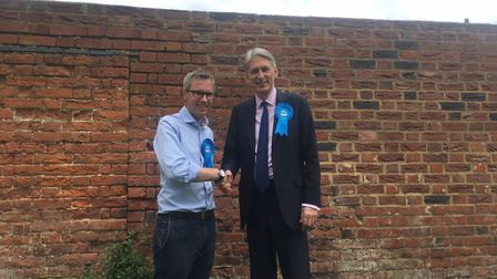 Chancellor of the Exchequer Philip Hammond, right, with North Norfolk Conservative candidate James W