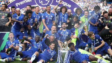 Chelsea players celebrate with ther trophy after the Premier League match at Stamford Bridge, London