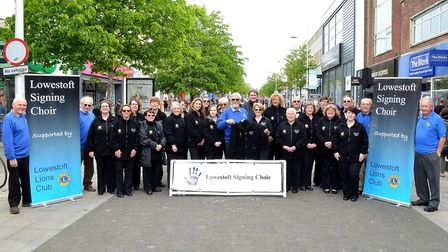 Lowestoft Lions present the new uniform to Lowestoft Signing Choir (LSC). Pictures: Mick Howes