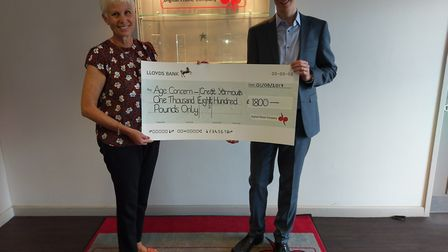 Jackie Tierney receives the £1,800 cheque from Chris Share Picture supplied by Chris Share