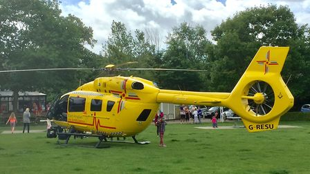 The air ambulance from the East Anglian Air Ambulance (EAAA) charity lands in Normanston Park, Lowes