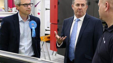 Liam Fox, Secretary of State for International Trade, and James Wild speaking to staff during their
