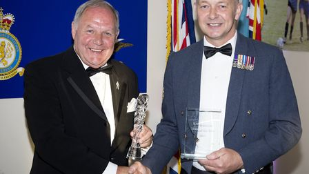 Peterborough United Director of Football Barry Fry presents the Coach of the Year award to Flight Se