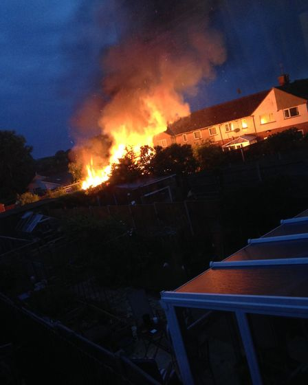 The fire, which started in the back of a property on Old Station Road, Halesworth. Photo: Chris Frie