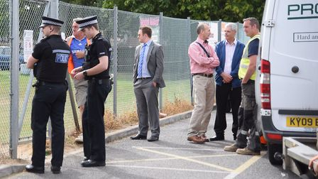 Police, councillors and the contractors watch the families and people from the Wymondham community p