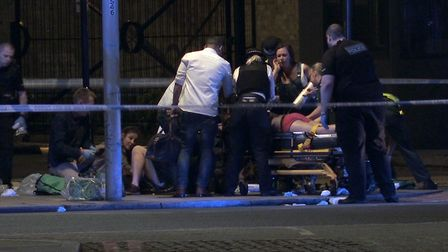 Screengrab taken from PA Video footage of people receiving medical attention in Thrale Street near L