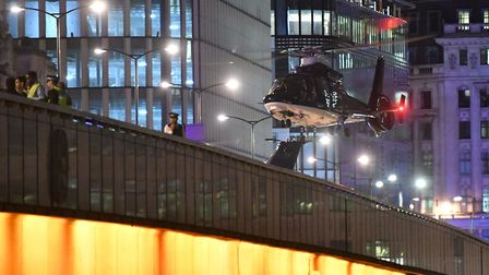 A second helicopter lands on London Bridge as police are responding to incidents in the capital. Pho
