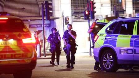 Armed police outside Monument station as police are responding to incidents in the capital. Photo: Y