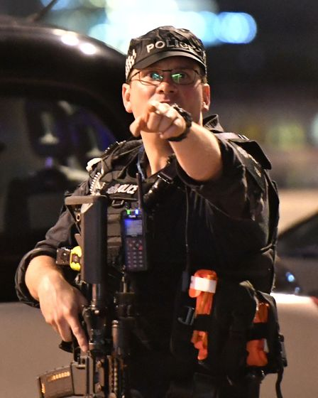 """Armed Police officer on London Bridge as police are dealing with a """"major incident"""" at London Bridg"""