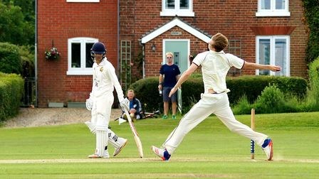 Young Swardeston paceman Tom Oxley in full flight against Bury St Edmunds at The Common. Picture: Ti