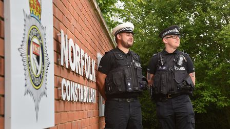 Norfolk Constabulary police constables Steve Potter, right, and Steve Lee helped Manchester Police i