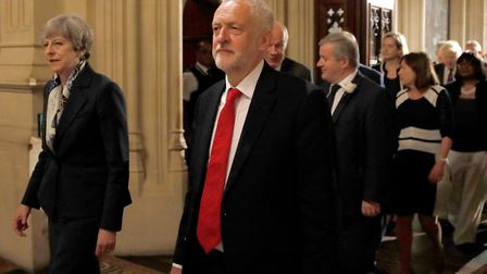 Prime Minister Theresa May and Labour leader Jeremy Corbyn walk through the Peers Lobby during the S