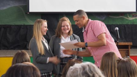 Clive Lewis MP presenting the Schools of Sanctuary award certificate to pupils from Jane Austen Coll