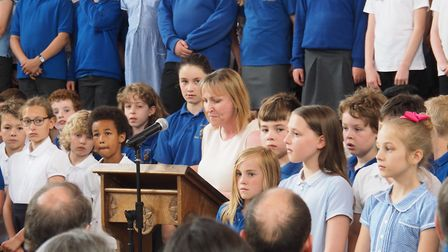 Debbie Dismore, Headteacher, surrounded by Year 5 pupils from Avenue Junior School. Photo: Jake Brow