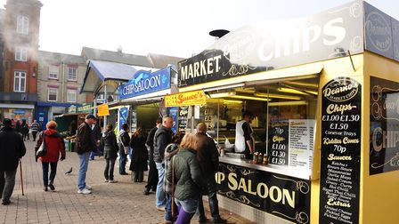 Eating chips from the chip stalls on Great Yarmouth market place. Picture: James Bass