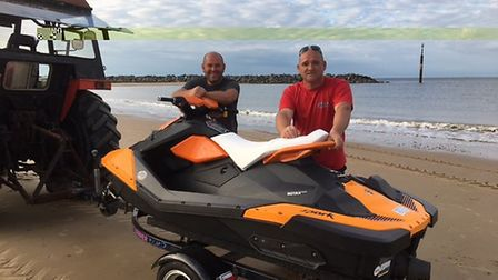 Craig Smith (left) and Pete Williams (right) with the jet ski used in the Sea Palling rescue. Pictur