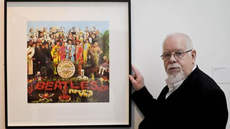 Peter Blake stands beside an image of the Beatles 'Sgt Pepper' album, which he designed. Picture: PA