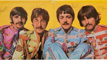 The inside of The Beatles' Sgt. Pepper's Lonely Hearts Club Band album autographed by the Fab Four.