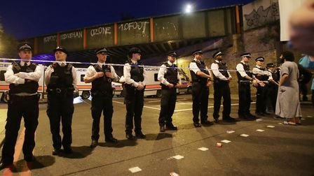 Police officers man a cordon at Finsbury Park in north London, after a terror attack on a Mosque. Pi