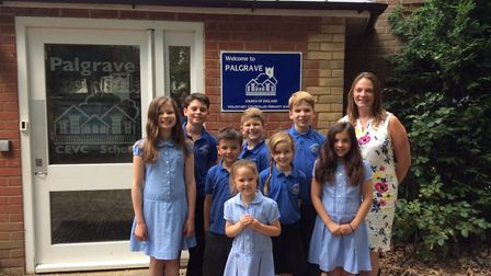 Headteacher Julia Waters and pupils from Palgrave Primary School celebrate an outstanding inspection
