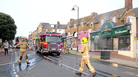 Firefighters tackle the fire at Fishers in Hunstanton. Pic: Chris Bishop.