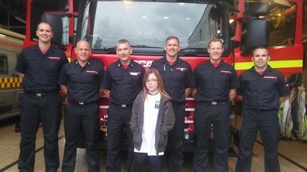 Milly Folkard and Green Watch at Sprowston Fire Station. She and her friend Charlotte Robinson raise