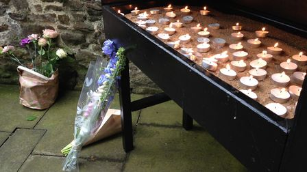 Candles and flowers at the King's Lynn vigil. Picture: Archant
