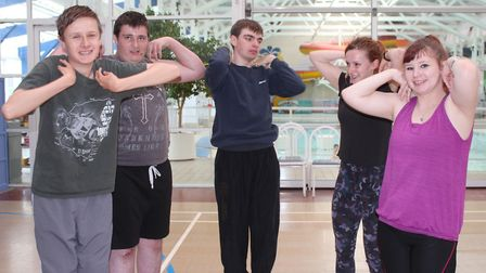Splash fitness instructor Kate Thomas (2nd right) puts Sidestrand Hall School students through their
