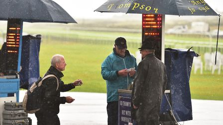 On course bookmakers brave the rain at Great Yarmouth races. Picture: Nick Butcher