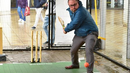 David Hannant playing on the new Criclet Simulator that is on Yarmouth Market place.