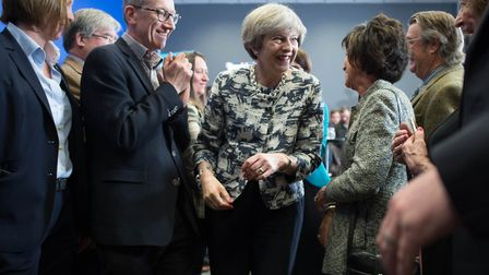 Prime Minister Theresa May is applauded by her husband Philip (left) after speaking at an event at T