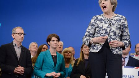 Prime Minister Theresa May speaking at an event at The Space in Norwich while her husband Philip lis