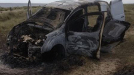 A van found burned out on Great Yarmouth beach. Picture: Submitted by anonymous