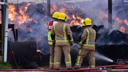 Firefighters tackling a barn fire in Mundham, Norfolk. earlier this year. Picture: NICK BUTCHER