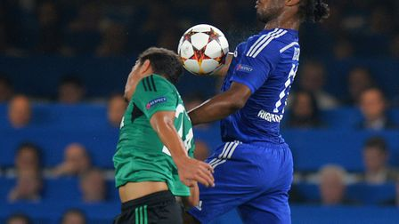 Kaan Ayhan in Champions League action against former Chelsea striker Didier Drogba. Picture: Tony Ma