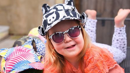 Harriet Watson, two, wearing one of her mum Emma's sunhats, with temperature regulating, mosquito an