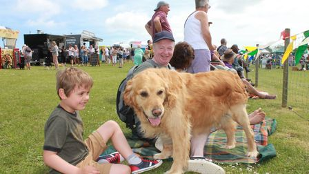 Watching the lurcher racing at North Norfolk Country Fair. Photo: KAREN BETHELL