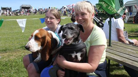 Gemma and Carolyn Steggles with dogs Dexter and Reggie watching the main arena attractions at North