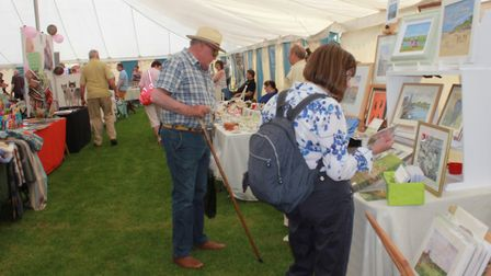 browsing the craft and produce stalls at North Norfolk Country Fair. Photo: KAREN BETHELL