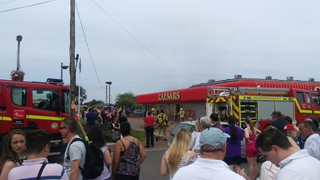 """A witness described seeing Caesars arcade on Beach Road fill-up with """"black smoke"""" shortly before 2p"""