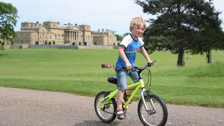 Tom Emerson, four, enjoying riding around the Holkham Estate for the Pedal Norfolk Cycling Festival.
