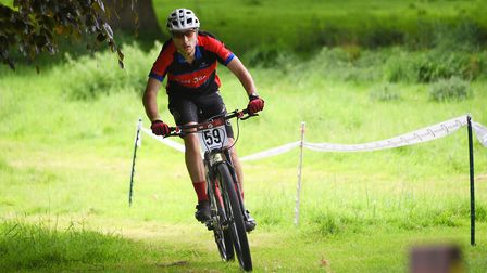 A cyclist on the mountain bike course at the Pedal Norfolk Cycling Festival on the Holkham Estate. P