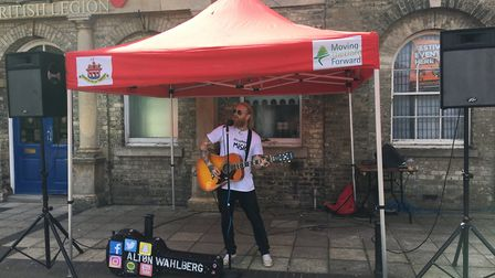 Alton Wahlburg performing as part of the action at a Spring into Summer Market on Thetford's Market