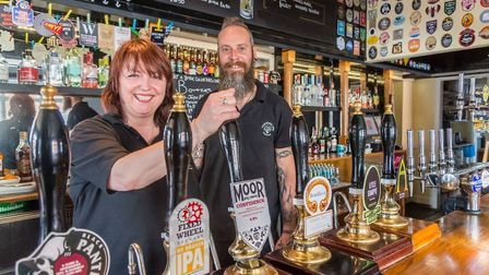Dawn Hopkins and her partner Carl Newell who own The Rose Inn on Queens Road. Picture: Stephen Mole