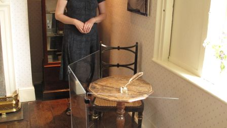 Victoria Connelly at Jane Austen's House Museum, Hampshire, with the table-top on which Jane wrote b