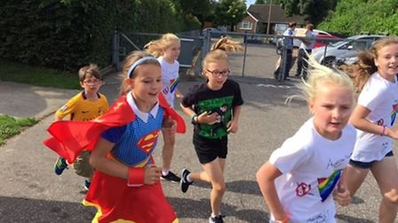 Children from Hethersett Junior School take part in a fun run for Macmillan Cancer Support. Picture: