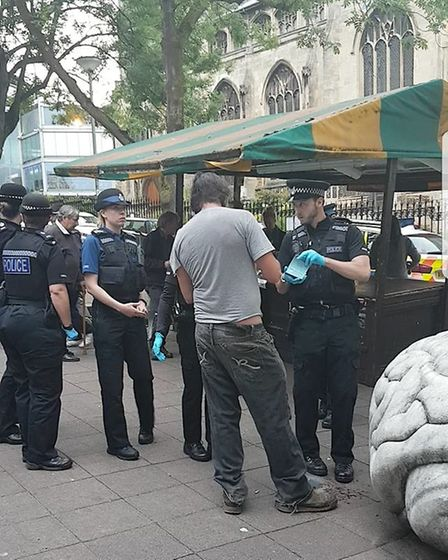 Police at the People's Picnic street soup kitchen on Saturday evening. Photo: People's Picnic.