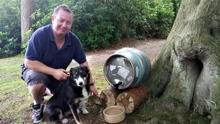 Peter Brough and his dog Pippa with one of the water stations. Picture: Fairhaven Garden